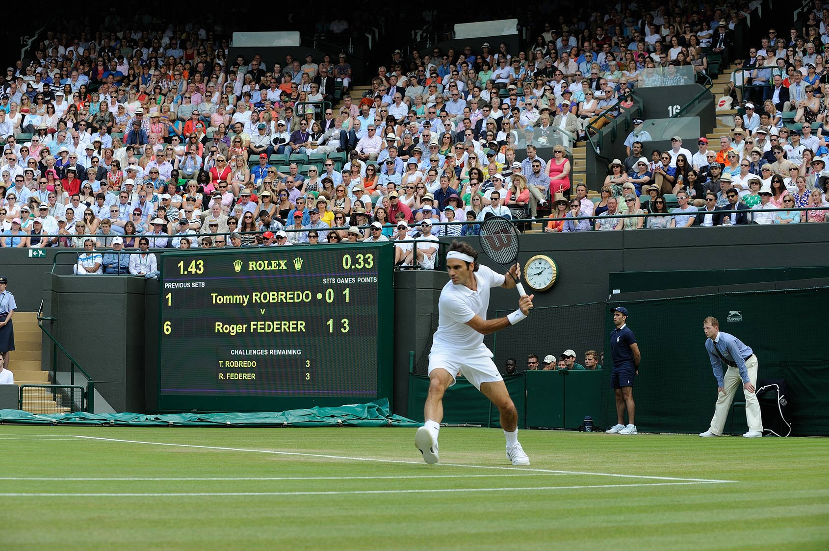 Roger Federer hitting backhand at Wimbledon